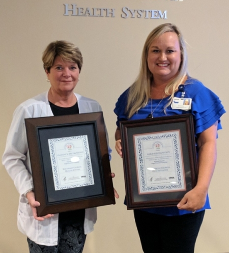 two nurses holding life link awards